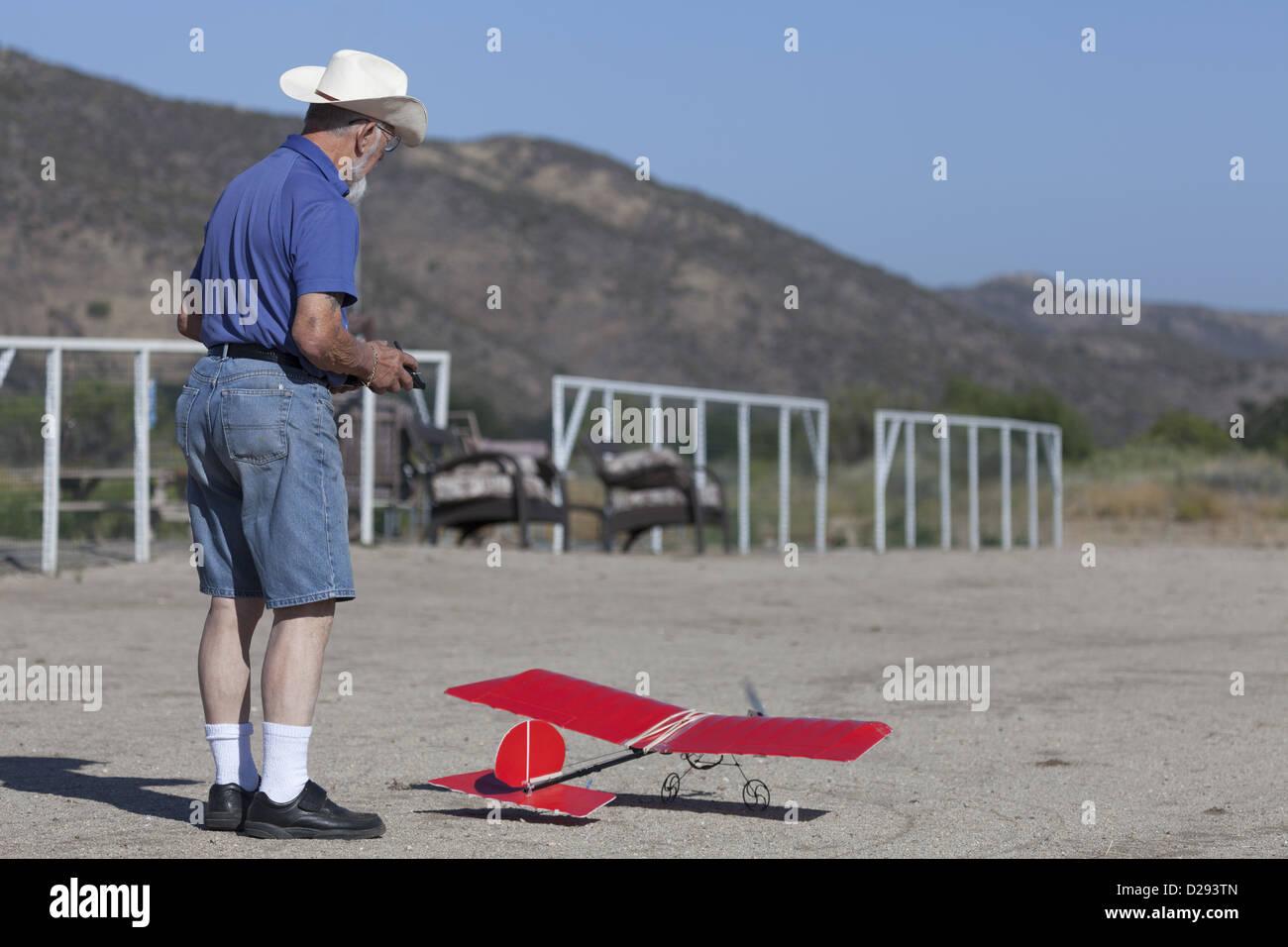 Senior man with a model airplane at model aircraft flying club at Rancho California RV Resort USA - Stock Image