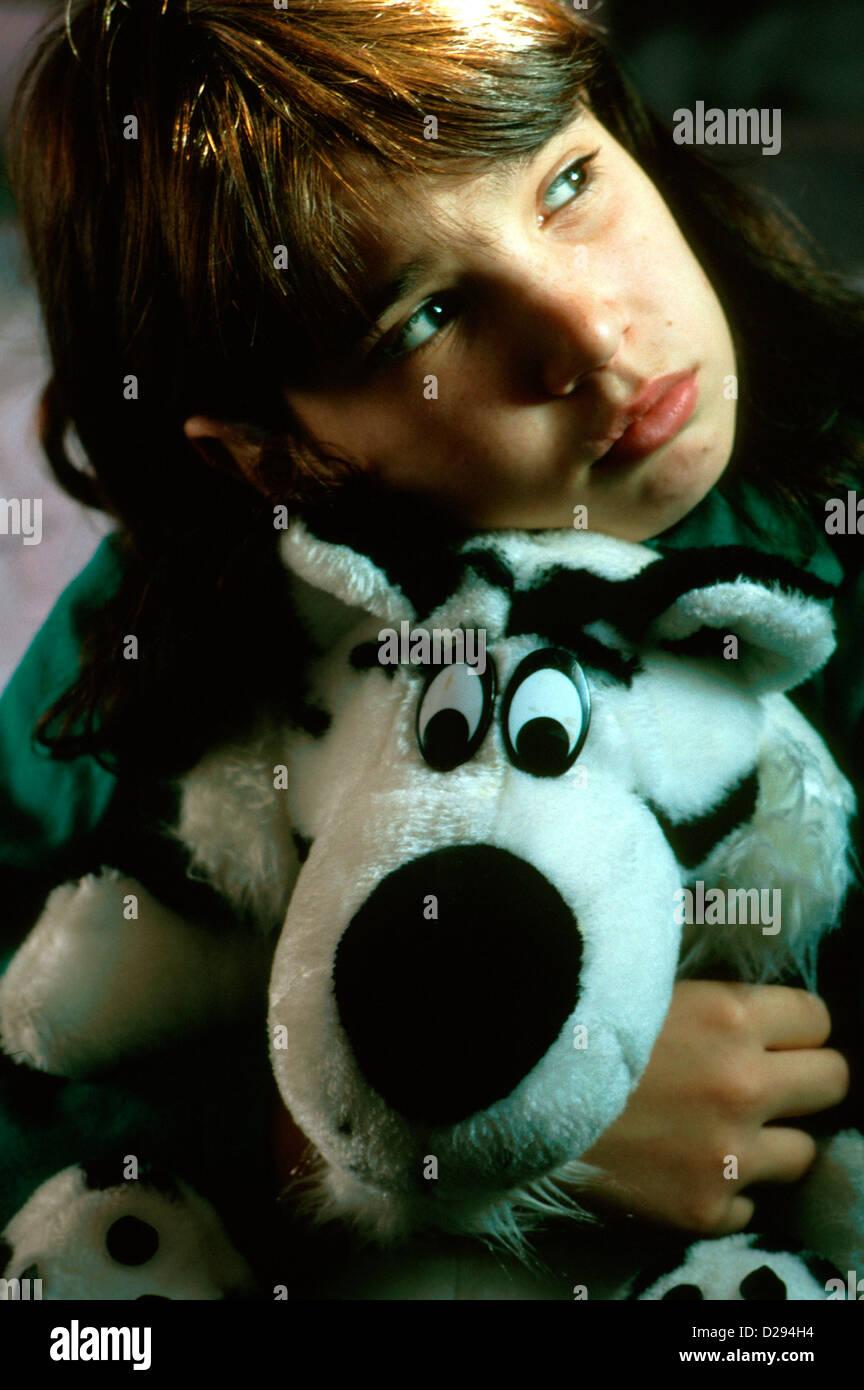 Eleven-Year-Old Girl, Hugging Stuffed Animal - Stock Image