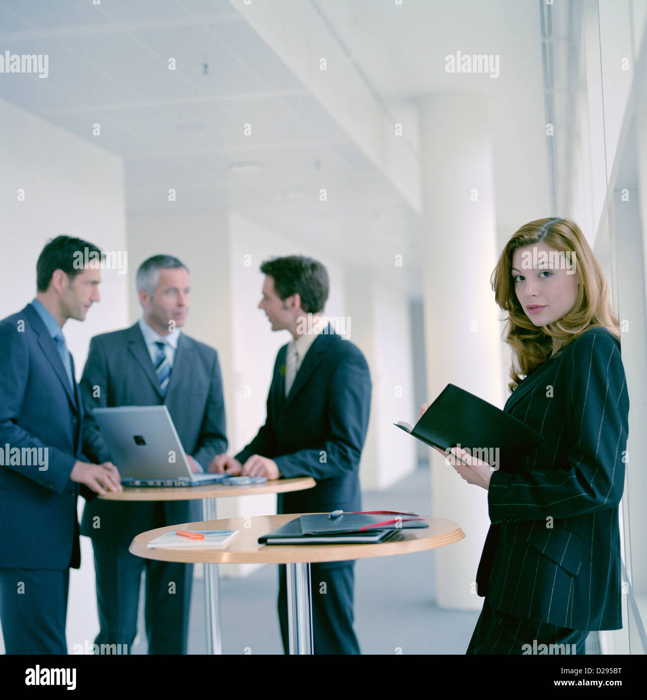 business people man woman using laptop License free except ads and outdoor billboards Stock Photo