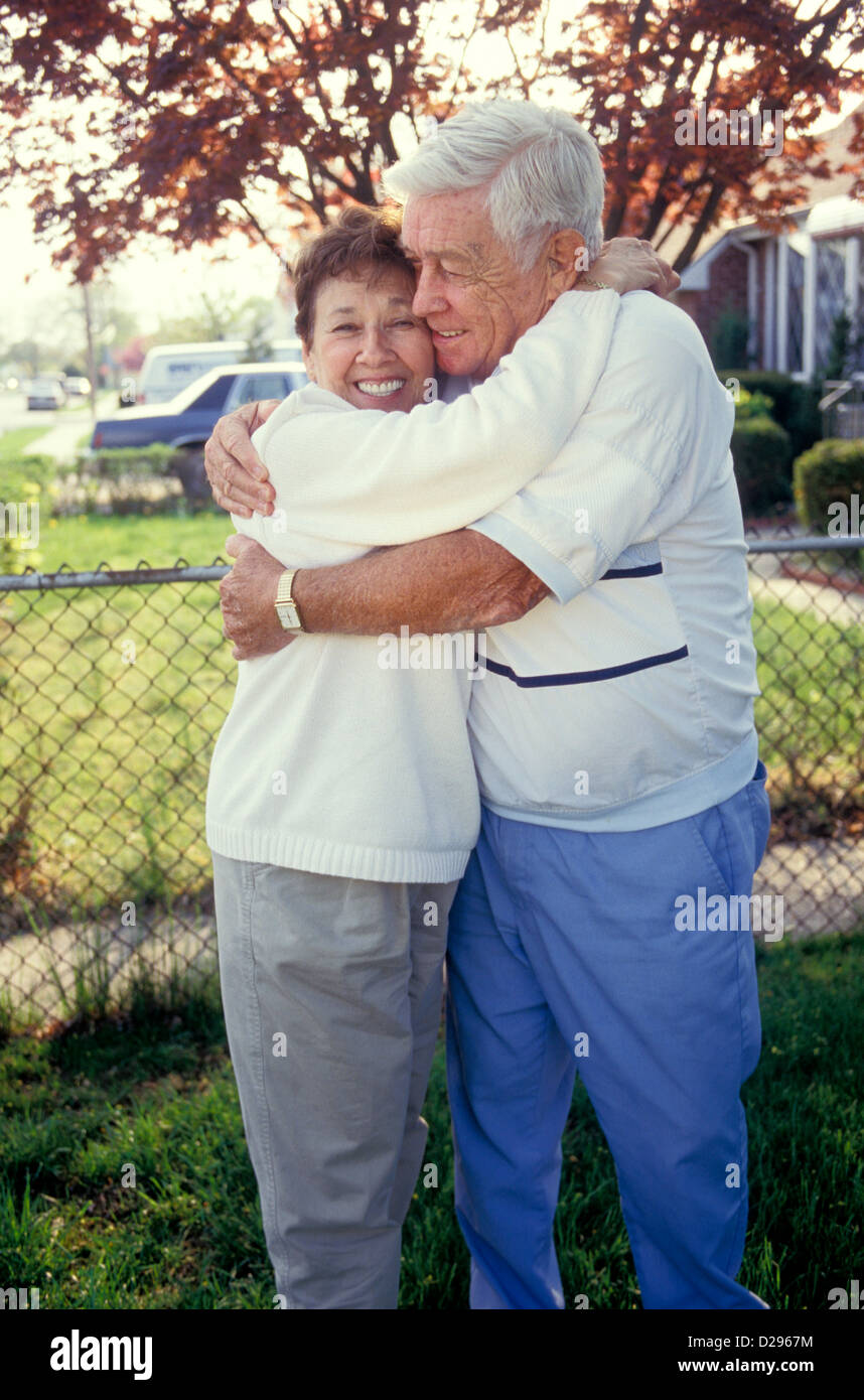 Seniors In Their 70S Hugging Each Other - Stock Image