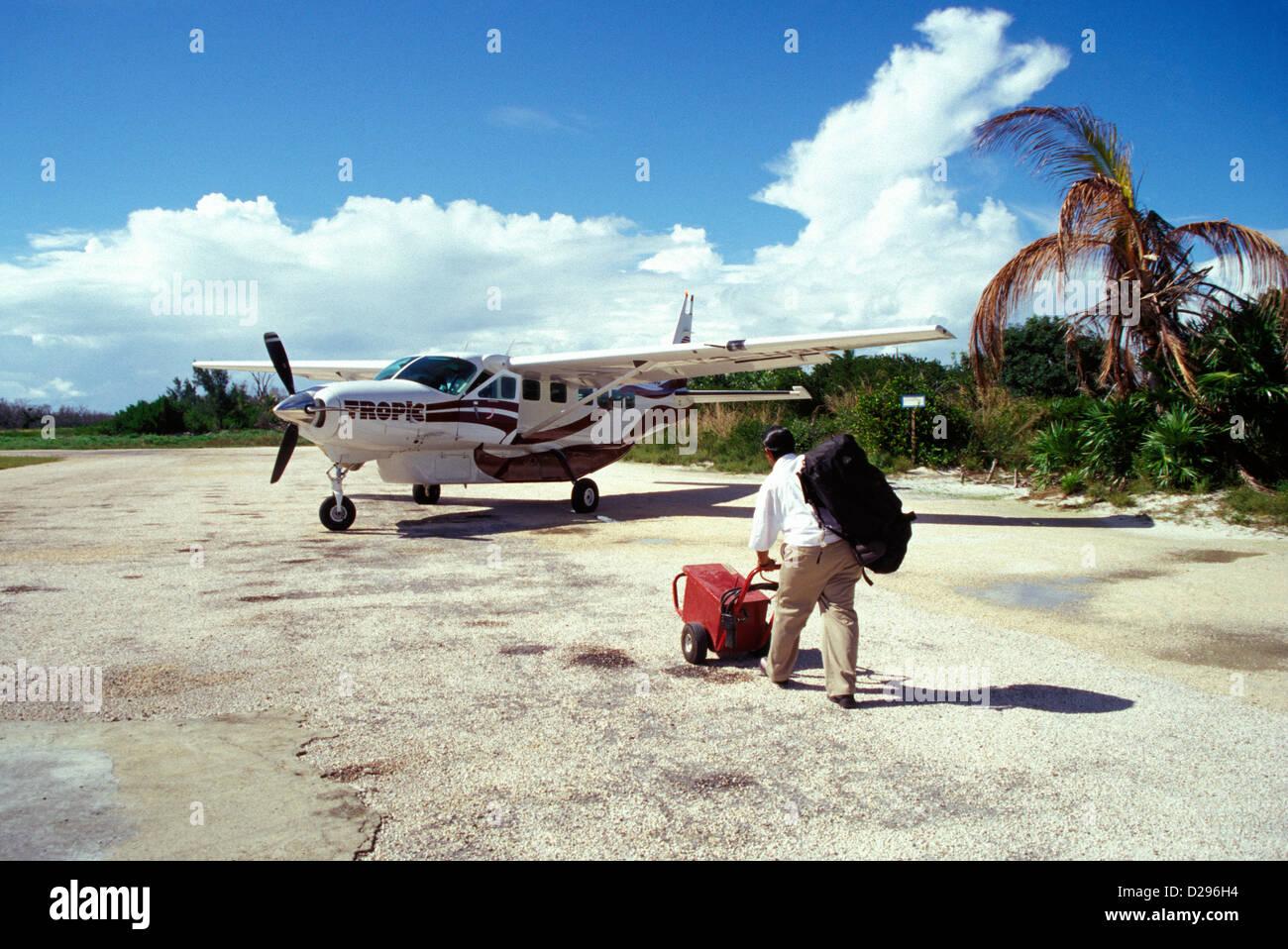 Belize, Caye Caulker. 12-Seater Airplane On Tarmac - Stock Image