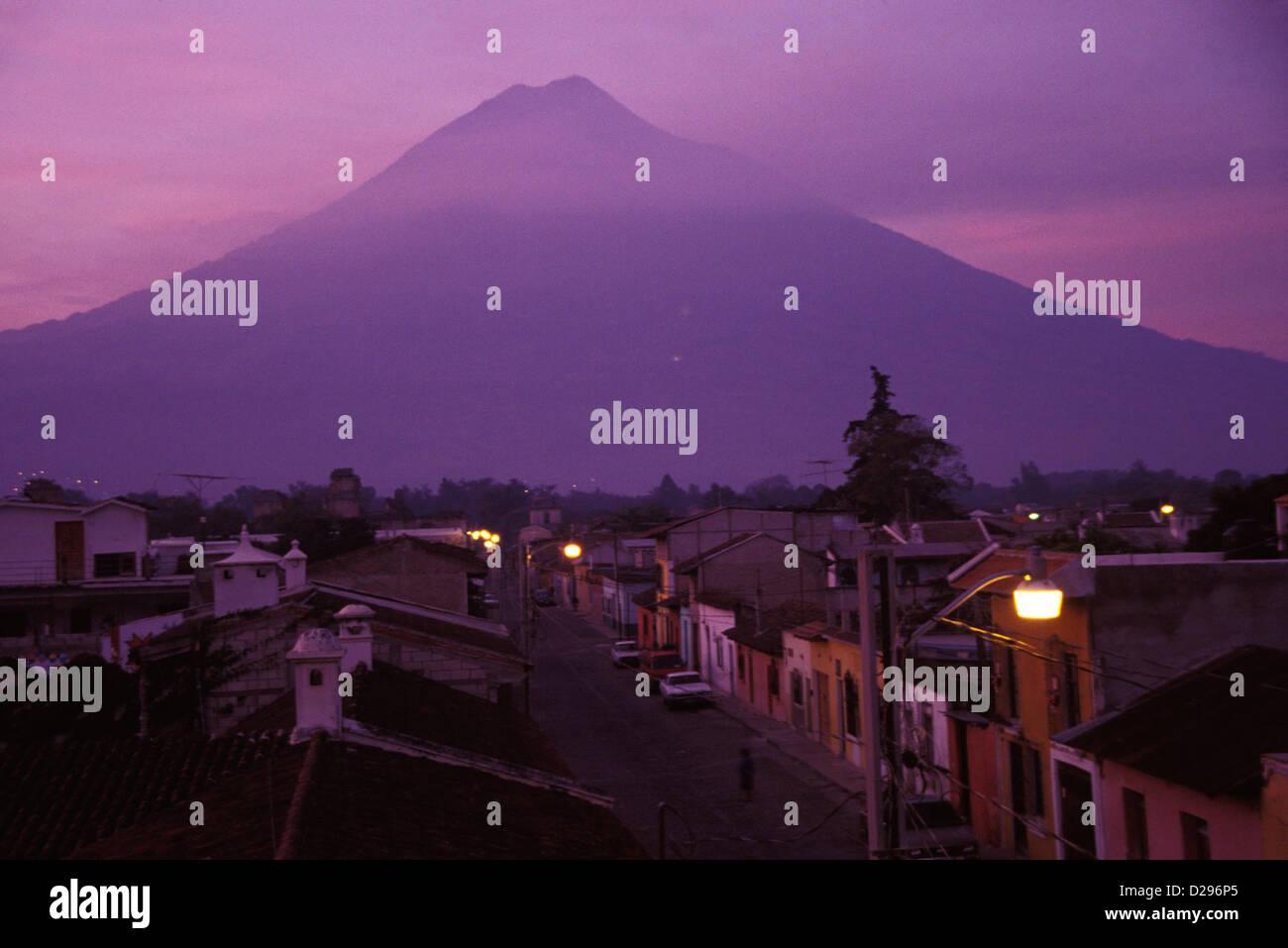 Guatemala, Antigua. Volcan Agua Volcano And Old Capital At Dusk - Stock Image