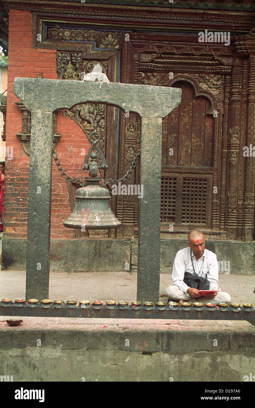 Nepal, Kathmandu. Monk Reading Holy Scripts In Temple. - Stock Image