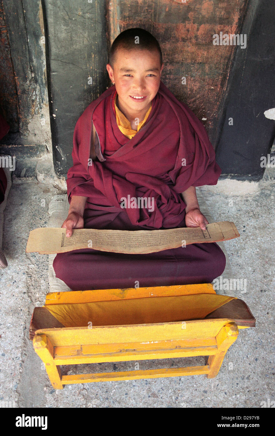 Tibet. Young Monk Studying Scripts. - Stock Image