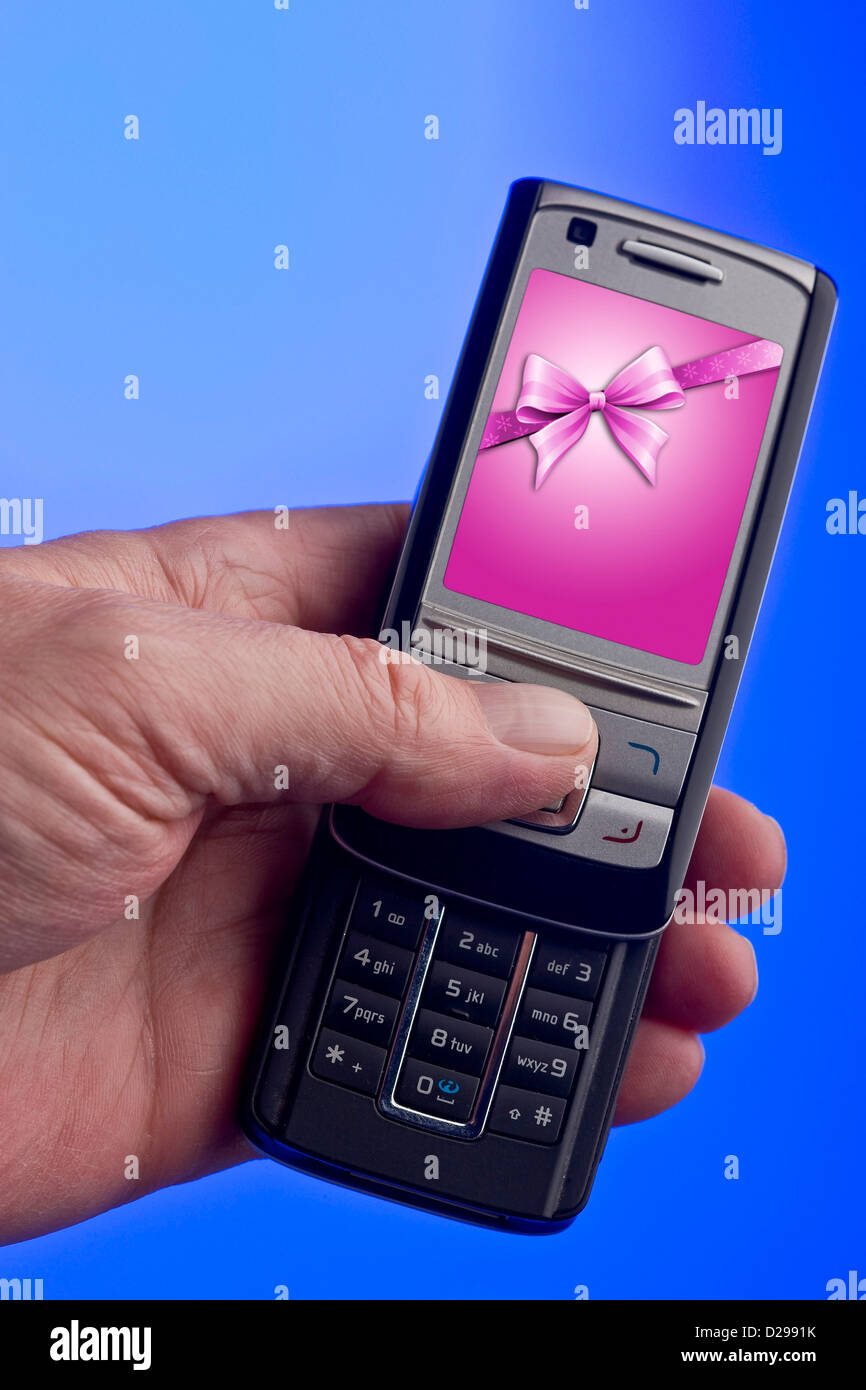 Mobile phone in left hand - Stock Image