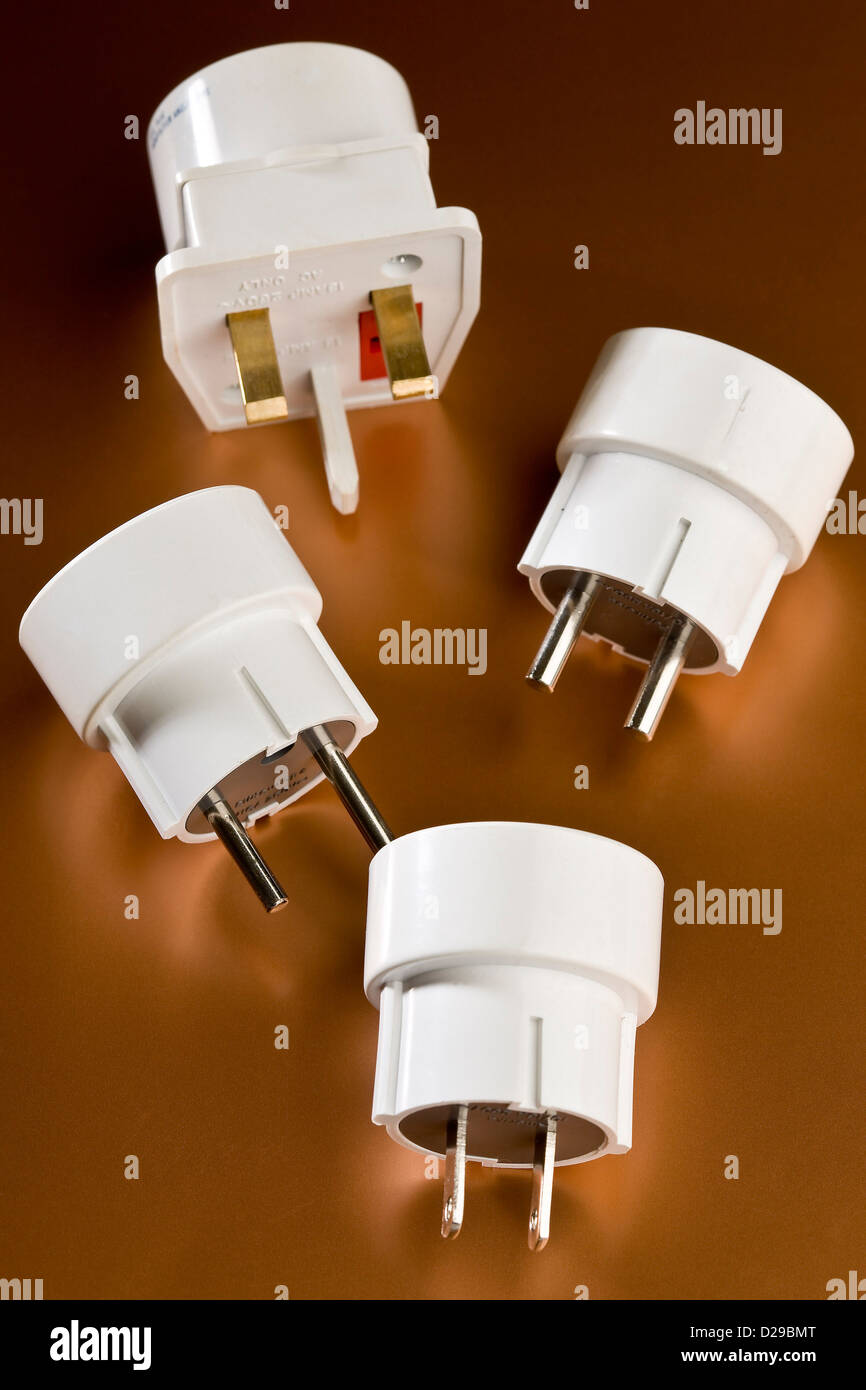 Four adaptor plugs for European, Af Stock Photo