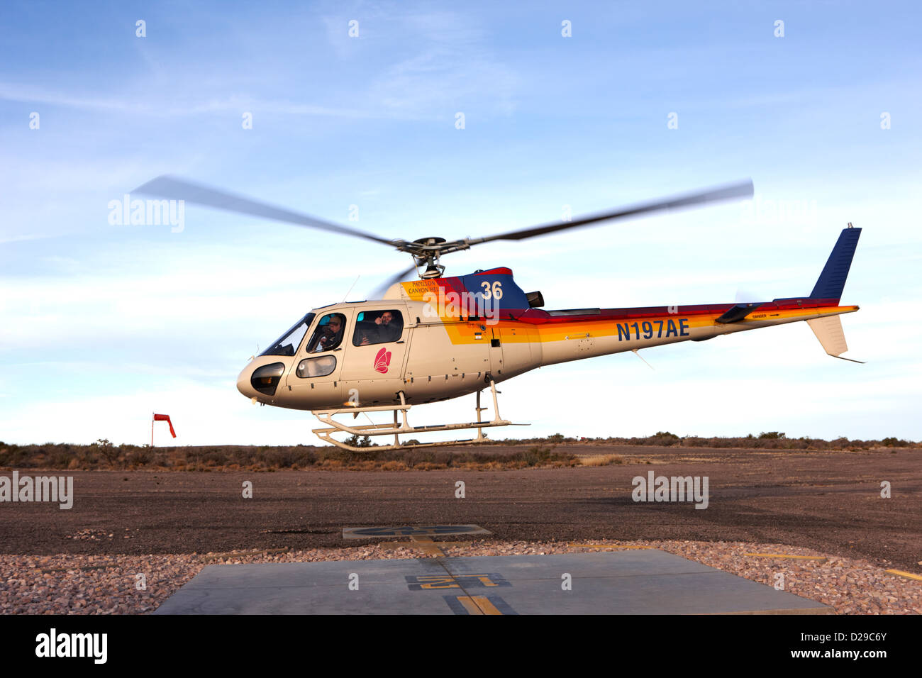 papillon helicopter tours full of passengers taking off from helipad Grand canyon west airport Arizona USA - Stock Image