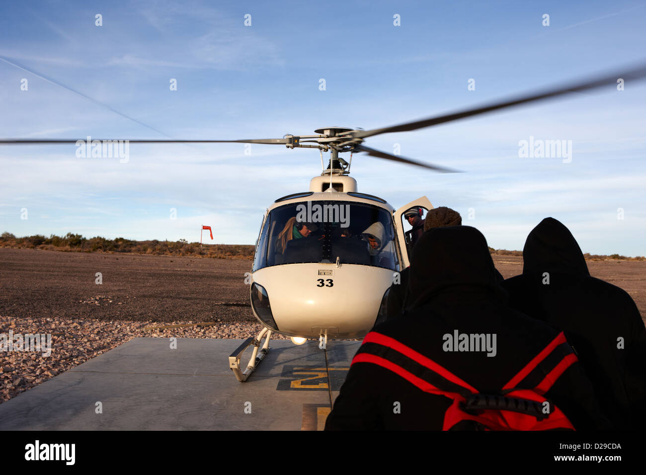 passengers boarding papillon helicopter tours on helipad at Grand canyon west airport Arizona USA - Stock Image