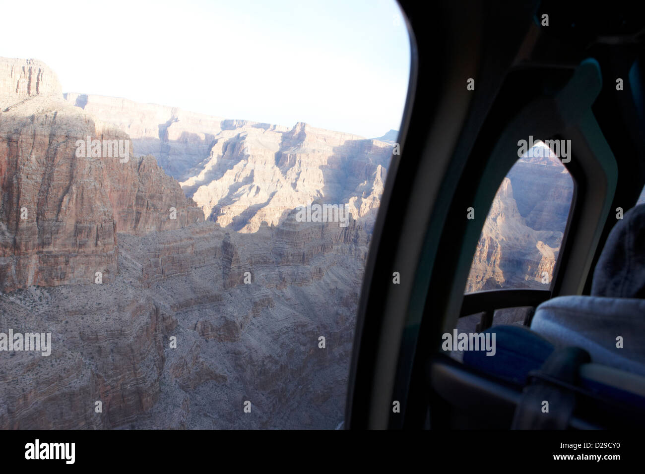 looking out of window into grand canyon on board papillon helicopter tour flying into Grand canyon Arizona USA - Stock Image