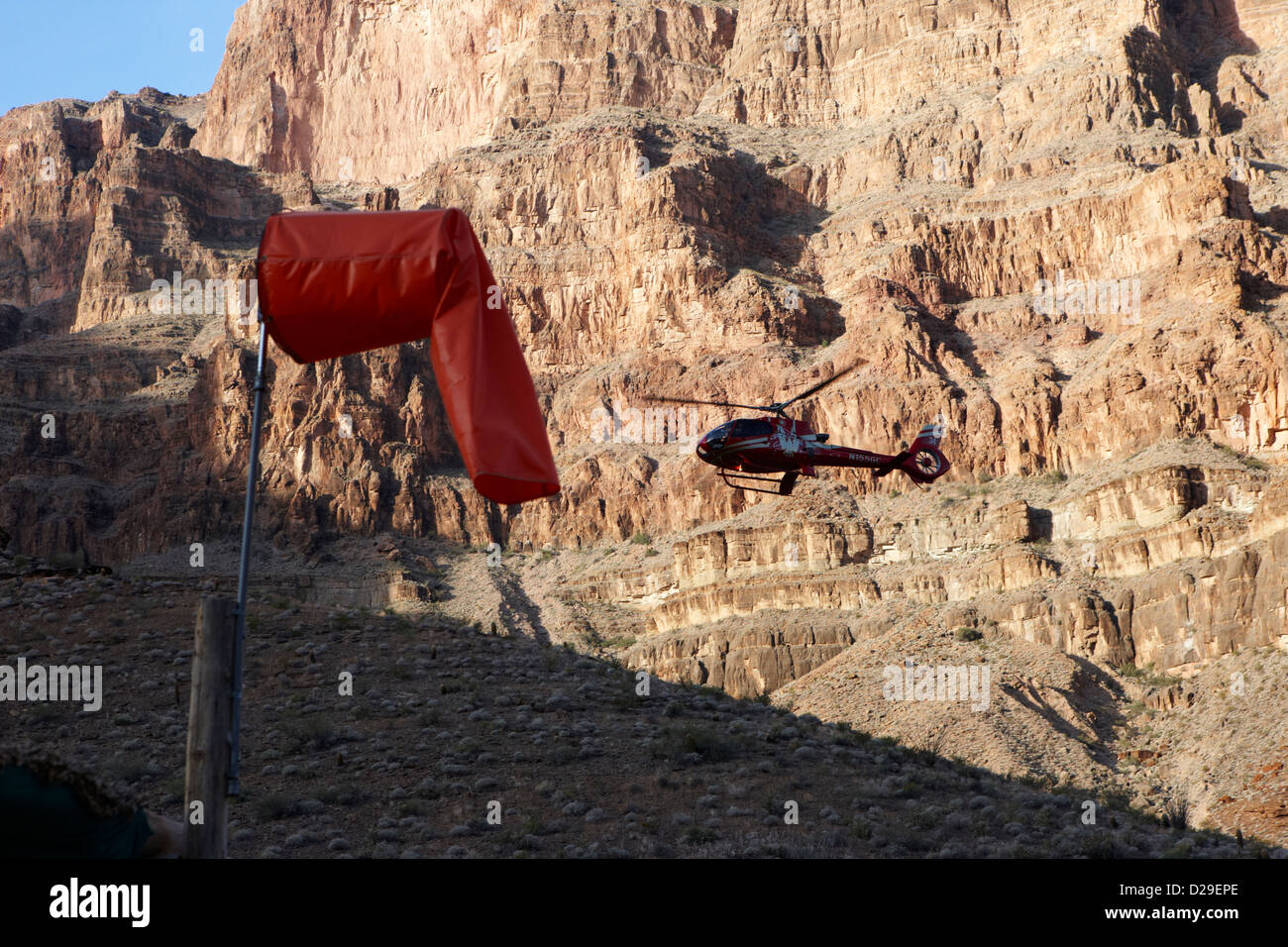 helicopter tours coming in to land on pad down in the Grand canyon Arizona USA - Stock Image