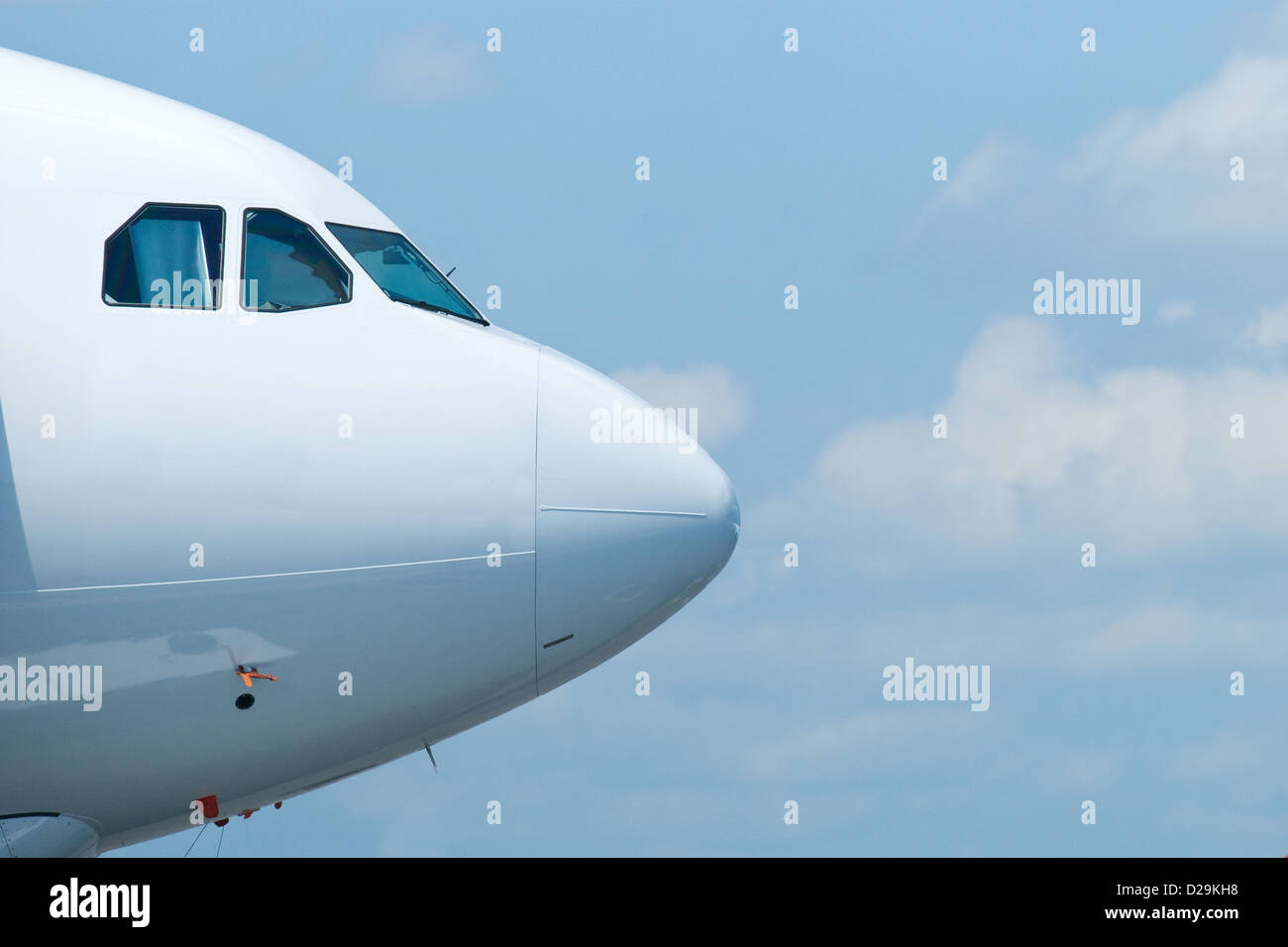 Front of wide-body airliner - Stock Image