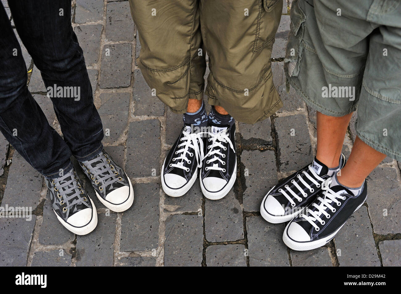 Teenagers with new Converse trainers sneakers - Stock Image
