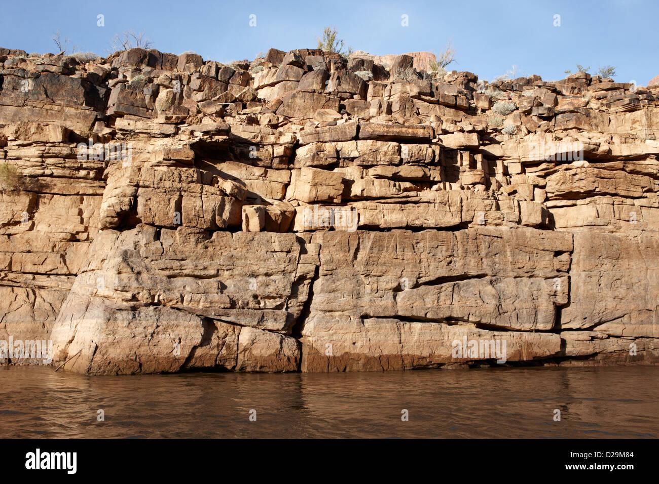 rock strata on the banks of the colorado river bottom of the grand canyon Arizona USA - Stock Image