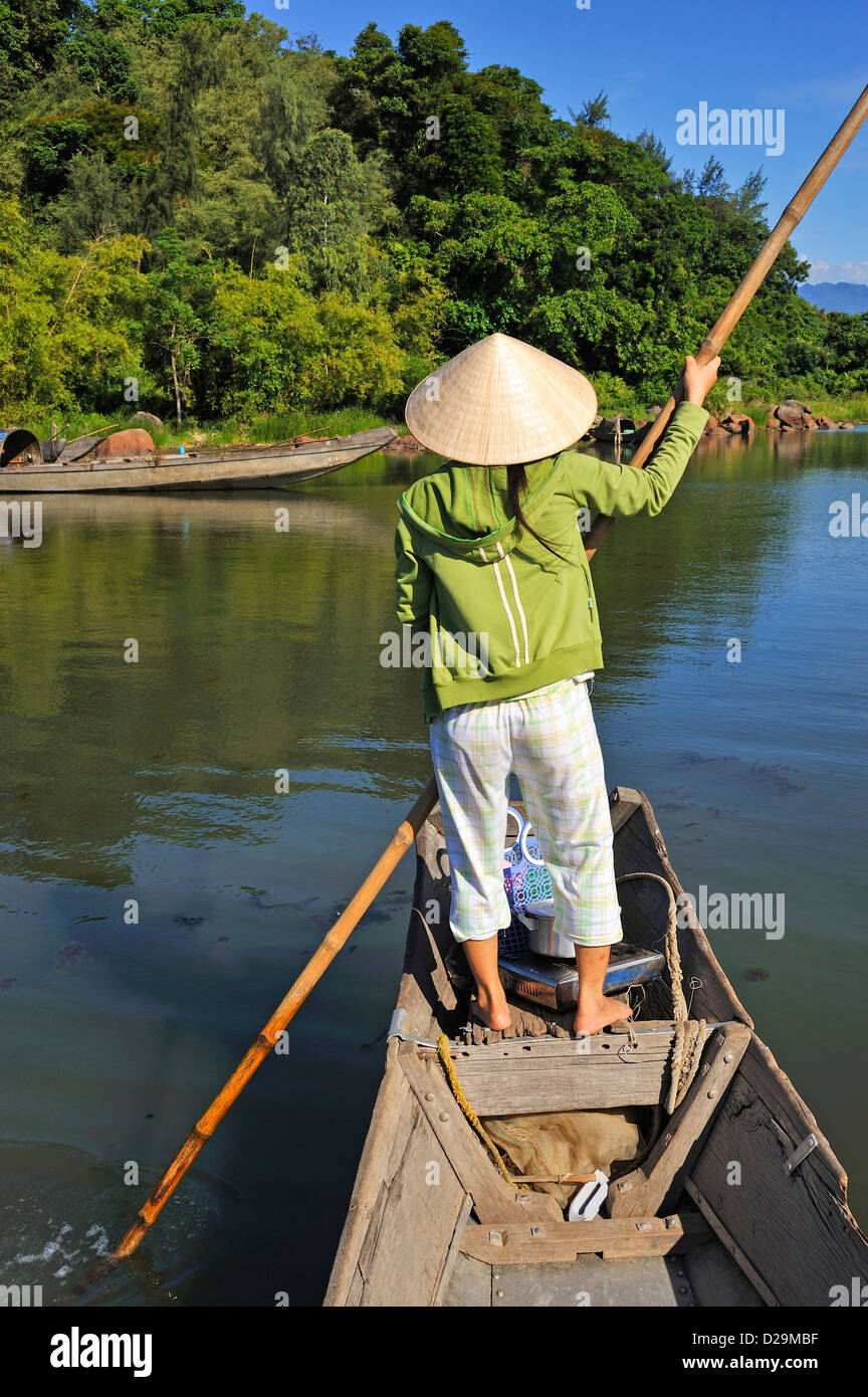 Woman paddling her boat on Phu Loc laguna lake, Vietnam - Stock Image