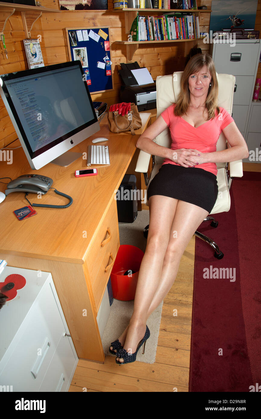 woman taking a break from her office chores stretching her legs at the deskher workplace