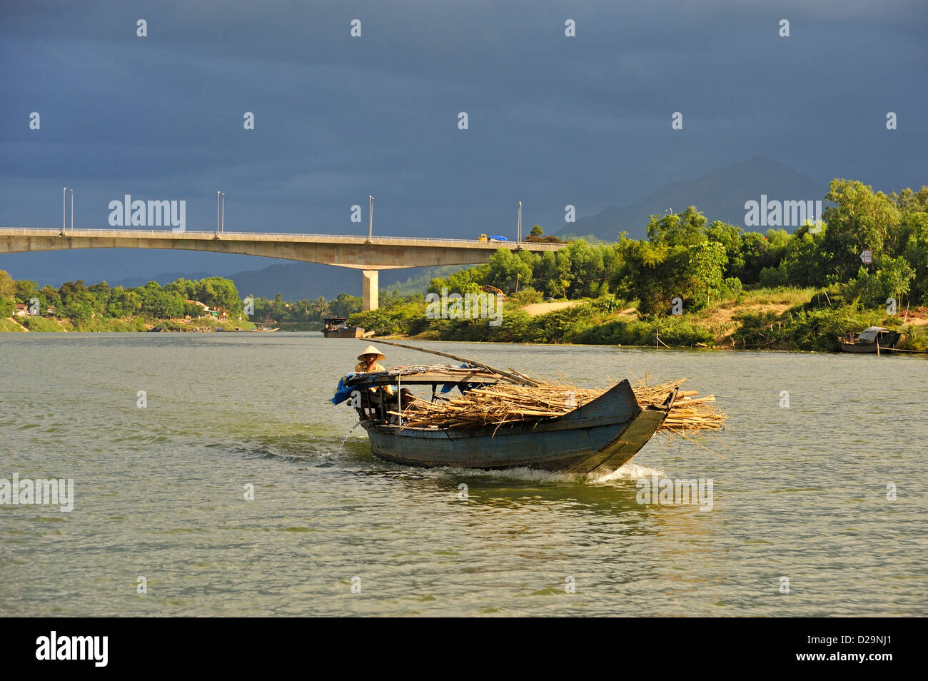 Boat carrying wood on the Perfume river, Hue, Vietnam - Stock Image