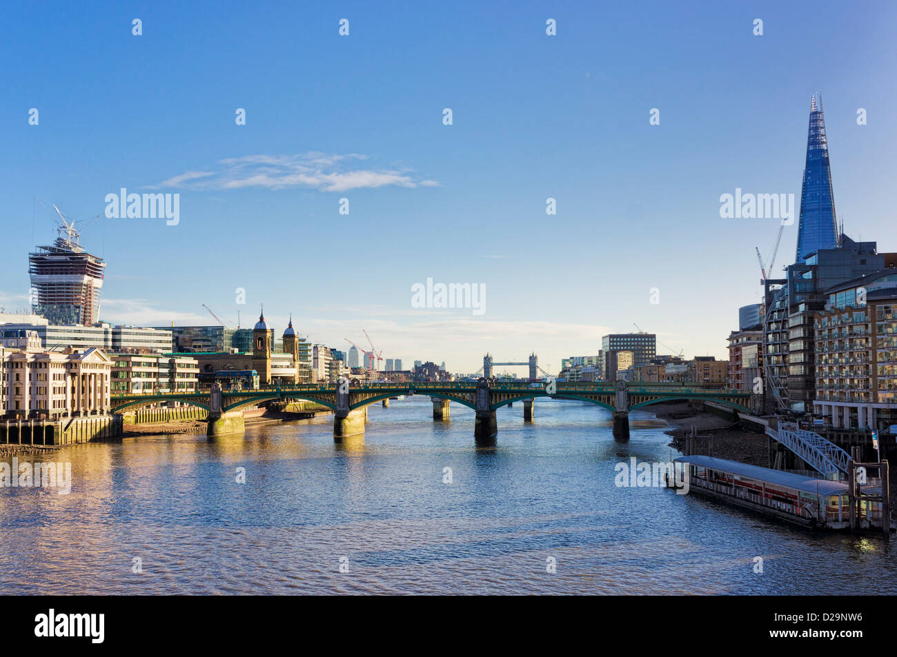 Southwark bridge over The River Thames and the city of London, England, UK - with the Shard - Stock Image