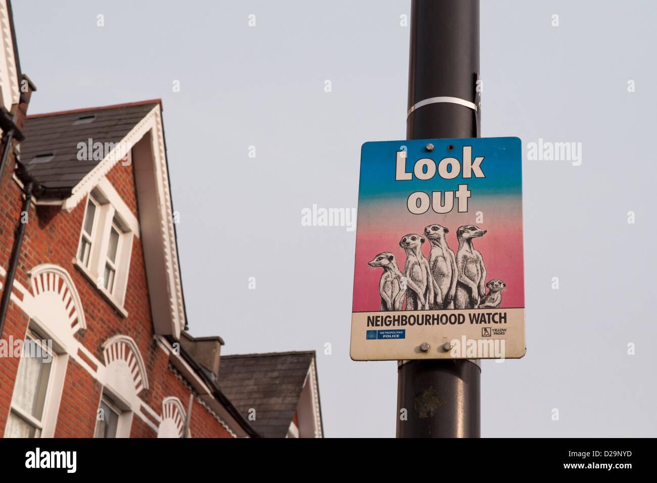 Neighbourhood watch sign on a lamppost on Endymion Road, Haringey, London UK. - Stock Image