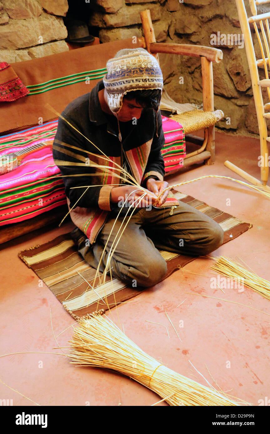 Man Weaving Reeds, Peru Stock Photo