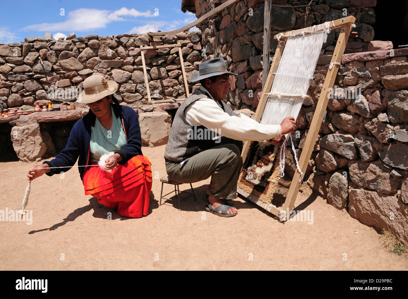 Man And Woman Weaving, Peru - Stock Image