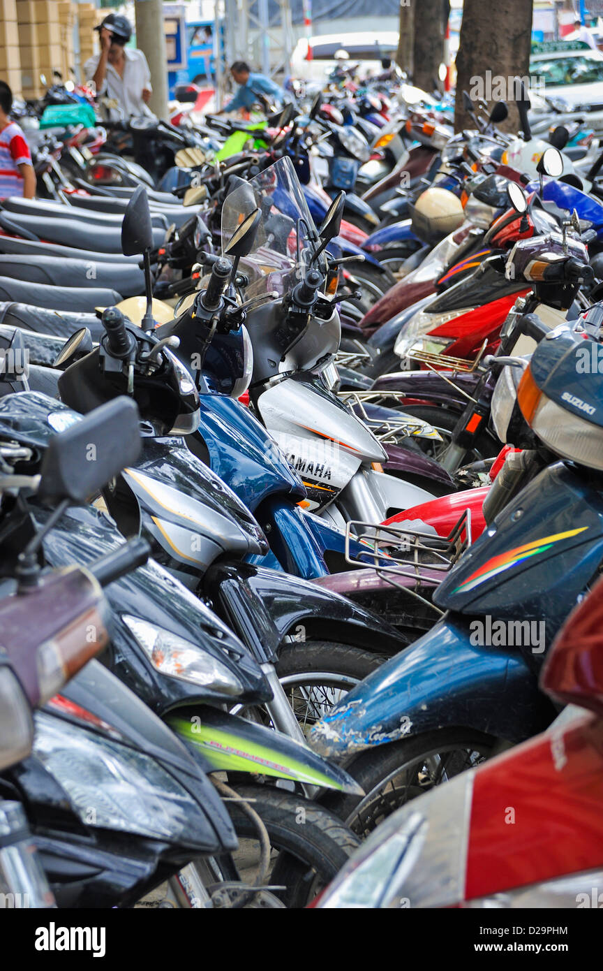 Scooters parked in Ho Chi Minh city centre, Vietnam - Stock Image