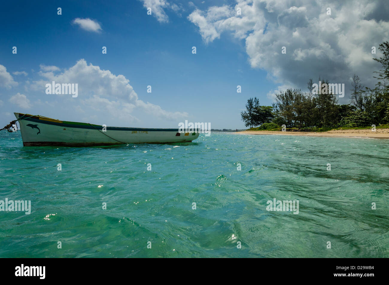Boat in the lagoon at Bel Ombre - Stock Image