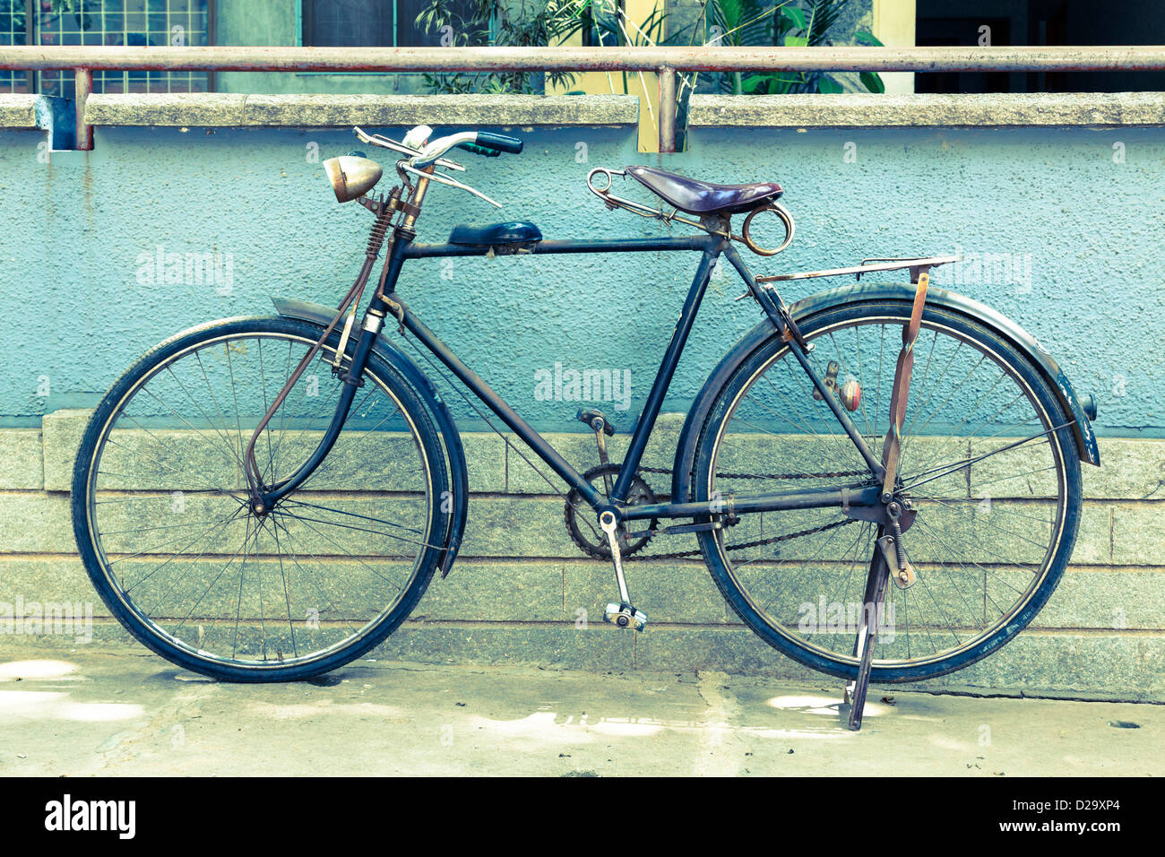 Vintage retro bicycle in India, cross-processed toned image - Stock Image