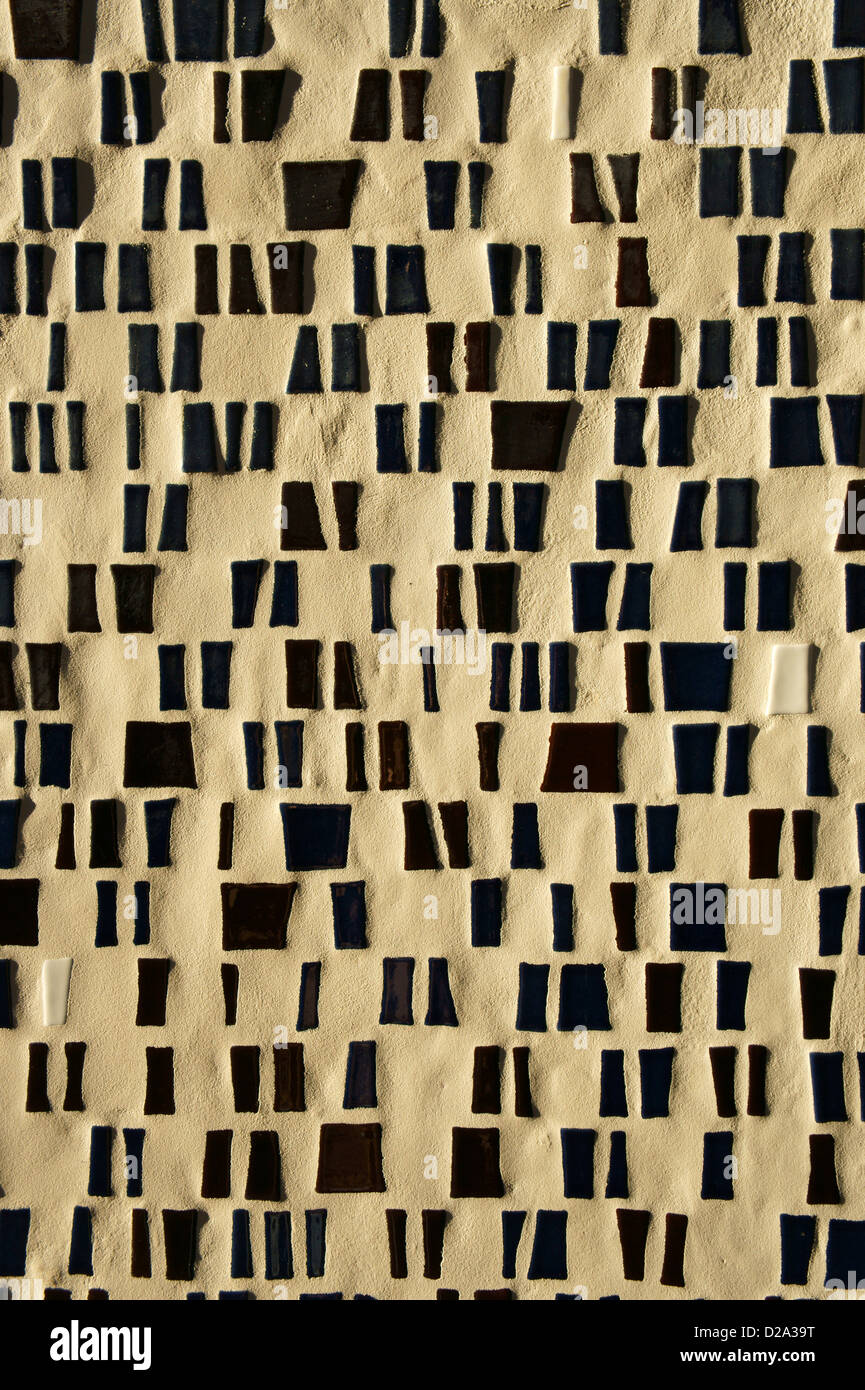 Black and white tile mosaic on the wall of a building - Stock Image