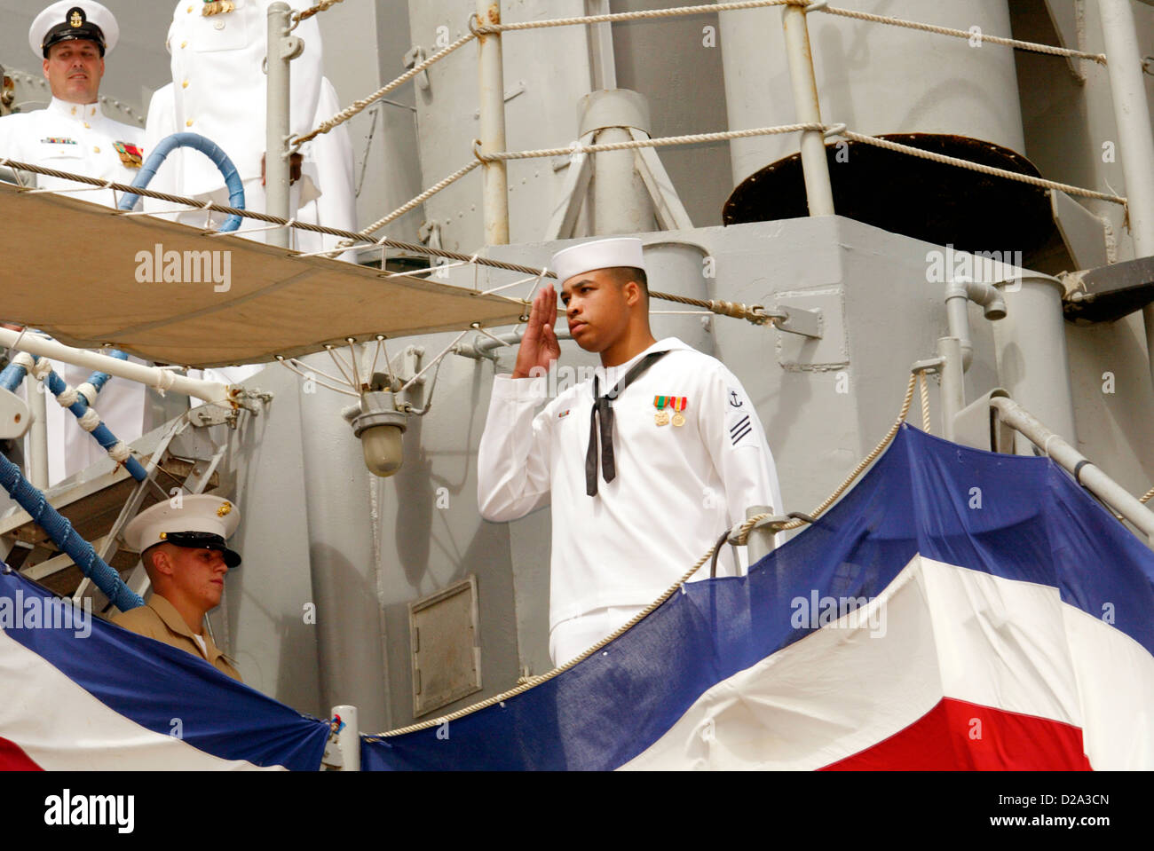 Honolulu Hawaii Crew Member Salutes Executive Officer Uss Frederick Before Debarking Ship During Decommissioning Stock Photo