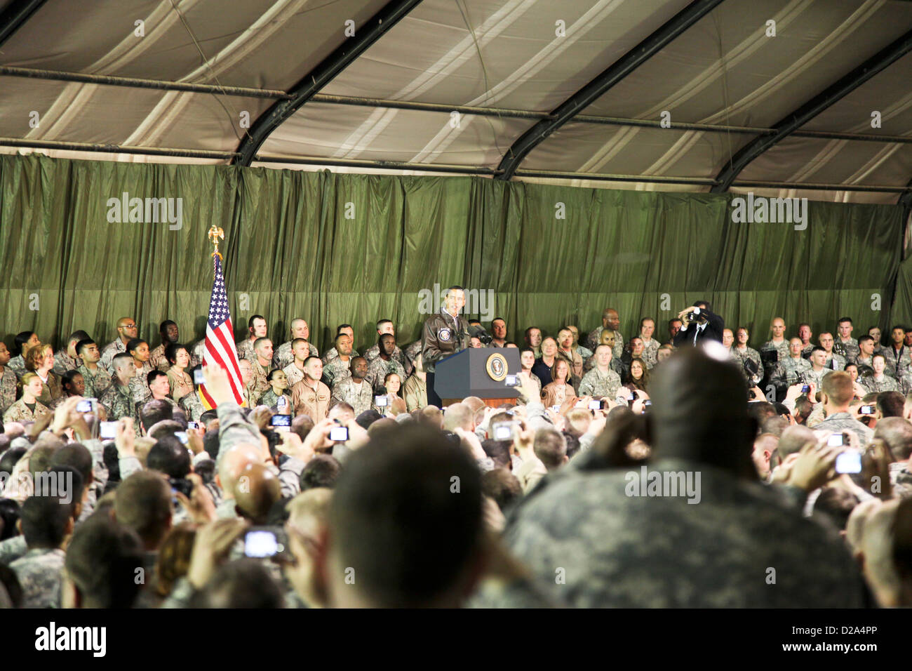 President United States Barack Obama Center Delivers Speech Crowd U.S Soldiers On Stage Inside Hanger Bagram Airfield - Stock Image