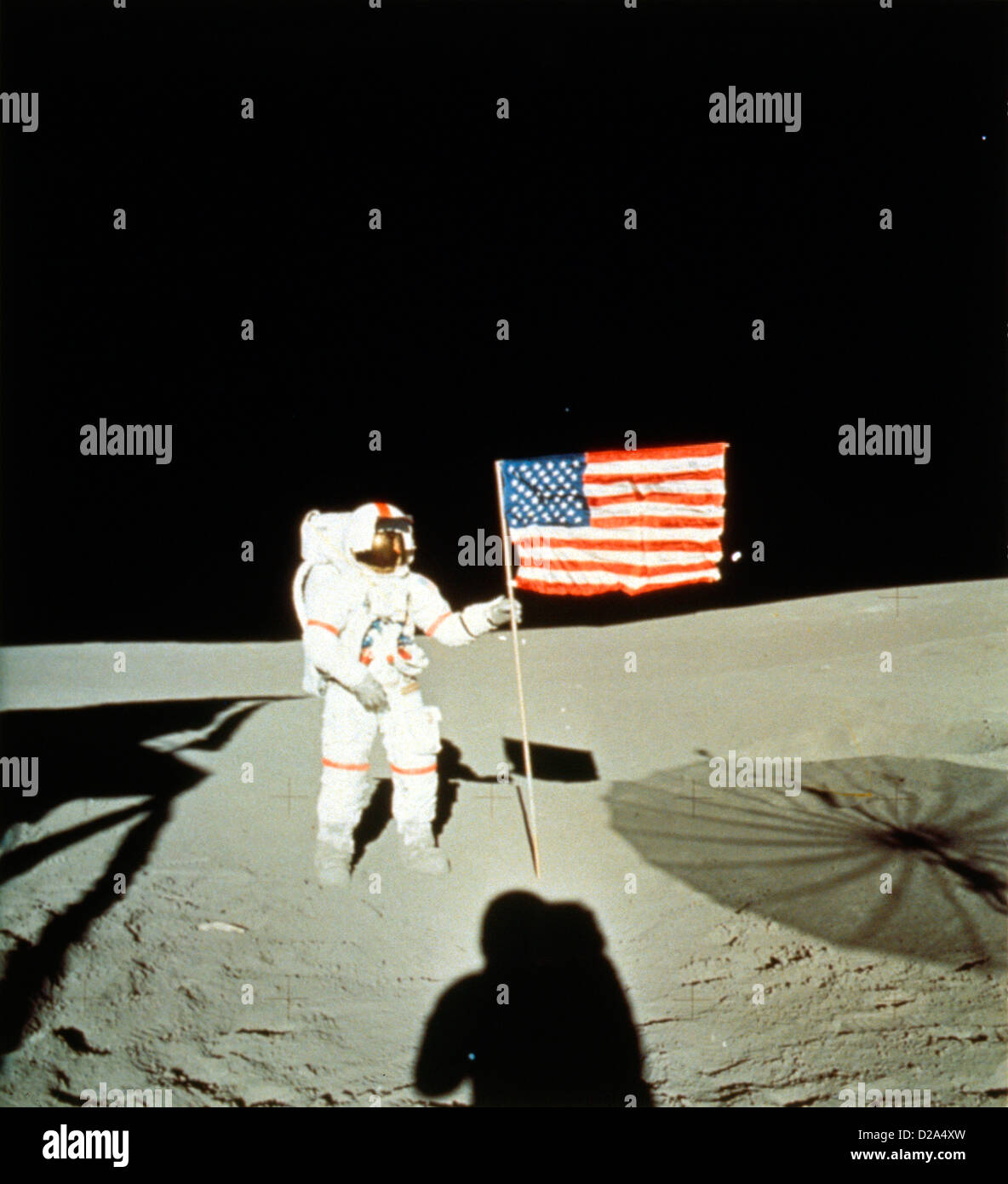 Astronauts, Shepard, Apollo 14, Stands With U.S. Flag On The Moon. - Stock Image