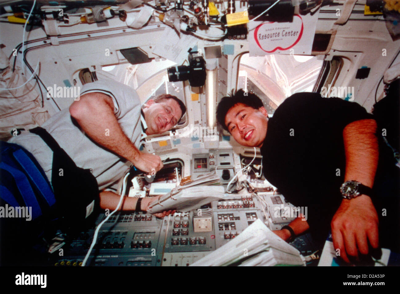 Two Astronauts Compare Notes On Discovery'S Aft Flight Deck. Stock Photo