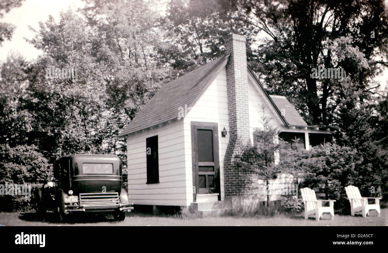 Cottage And Car Circa. 1930S. - Stock Image