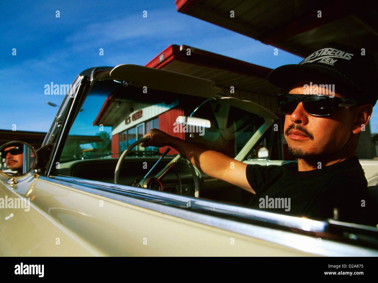 New Mexico, Espanola, Man W/ Moustache And Goatee, In Driver'S Seat Of 1964 Chevrolet Impala. Restricted Use - Stock Image
