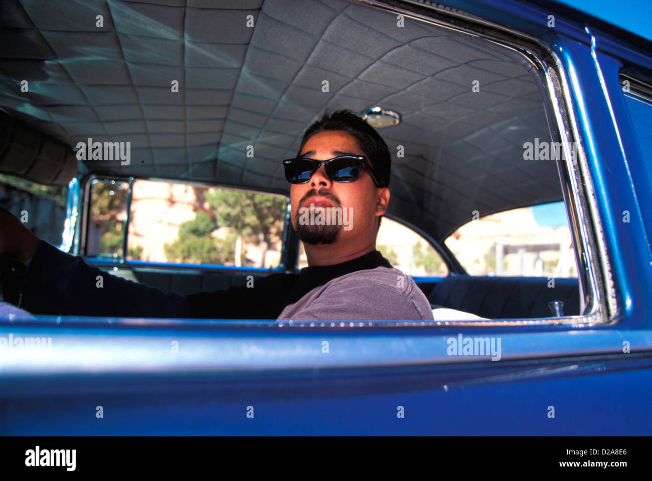 New Mexico, Chimayo, Man In His 1956 Chevrolet. Restricted Use - Stock Image