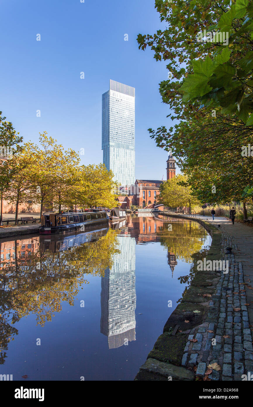 Castlefield, Manchester, England, UK, with canal and reflection of Beetham Tower in background - Stock Image