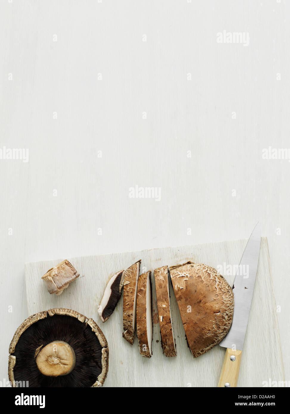 Mushroom on cutting board - Stock Image