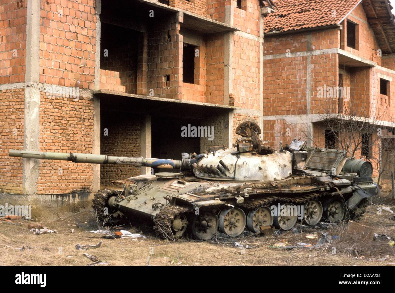 Albania, Kosovo, Peja. Serb Tank And Destroyed Houses.1999 - Stock Image