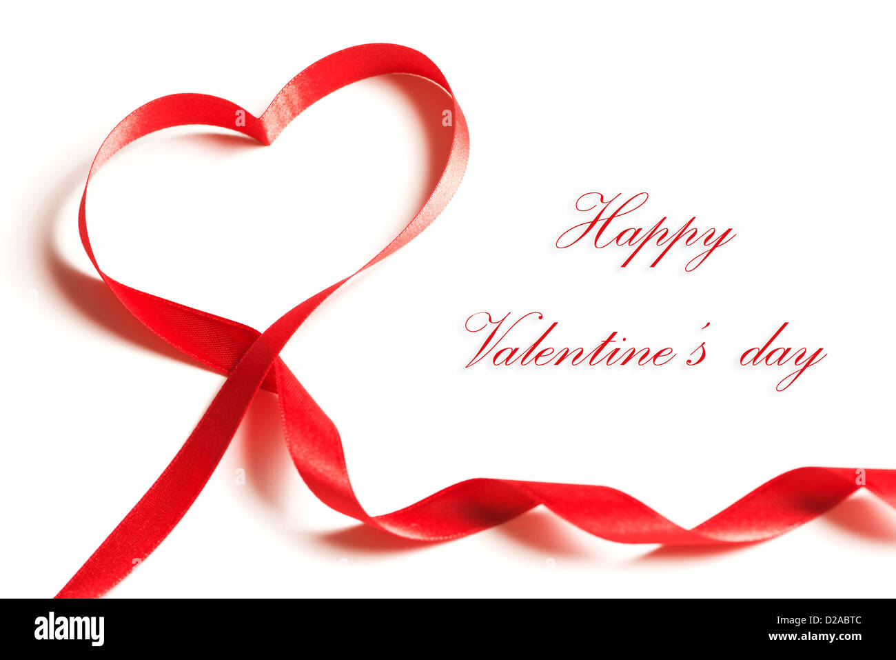 Valentine's day card - heart made of ribbon on white background - Stock Image