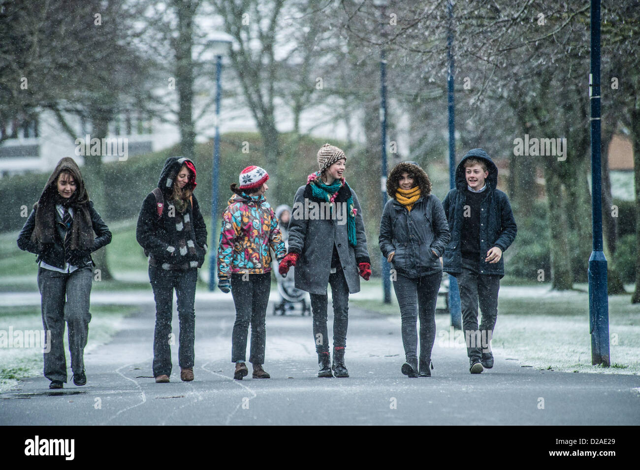 Aberystwyth, Wales, UK. 18th January 2013.  A group of 6th form pupils at Penweddig School walking to school as - Stock Image