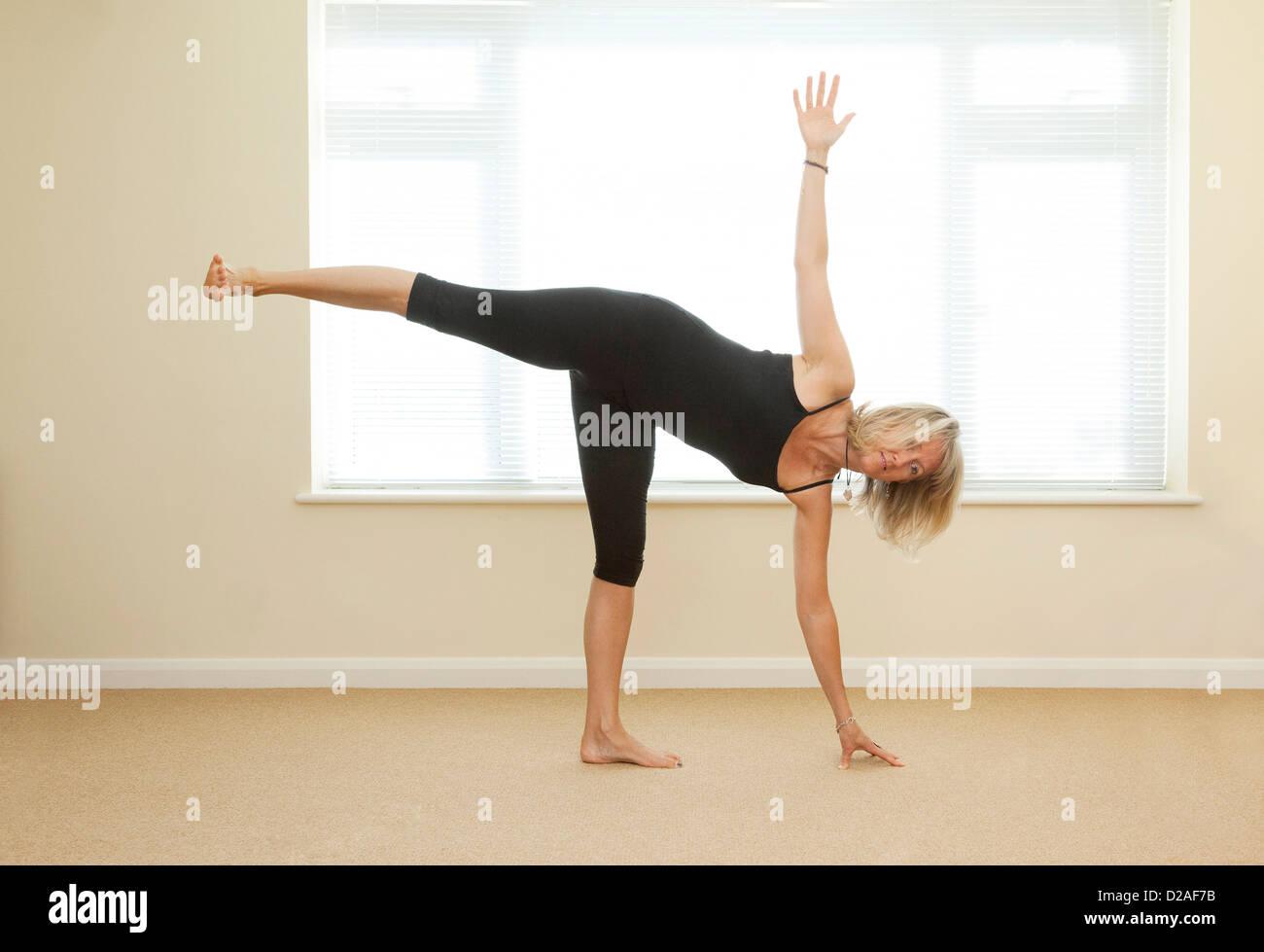 yoga pose - half moon - Stock Image