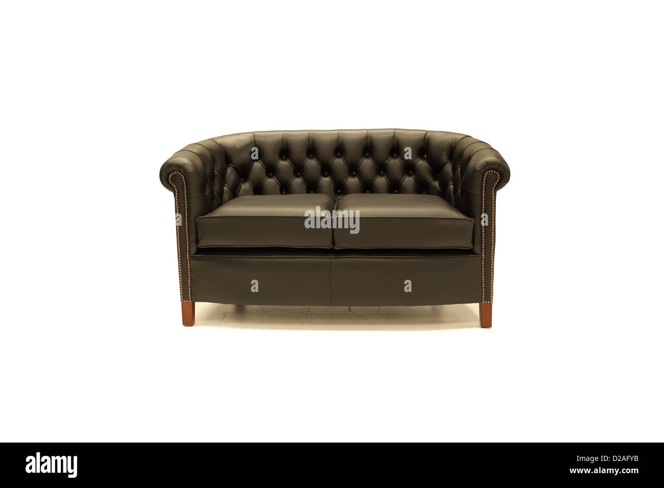 Leather chesterfield sofa - Stock Image