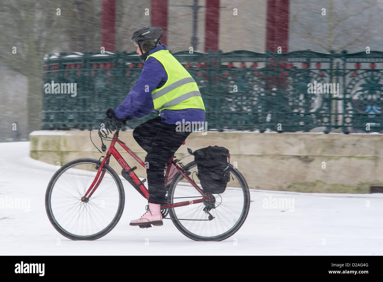 Snowfall makes commuting more challenging but does not stop dogwalkers or mothers taking their small children out - Stock Image