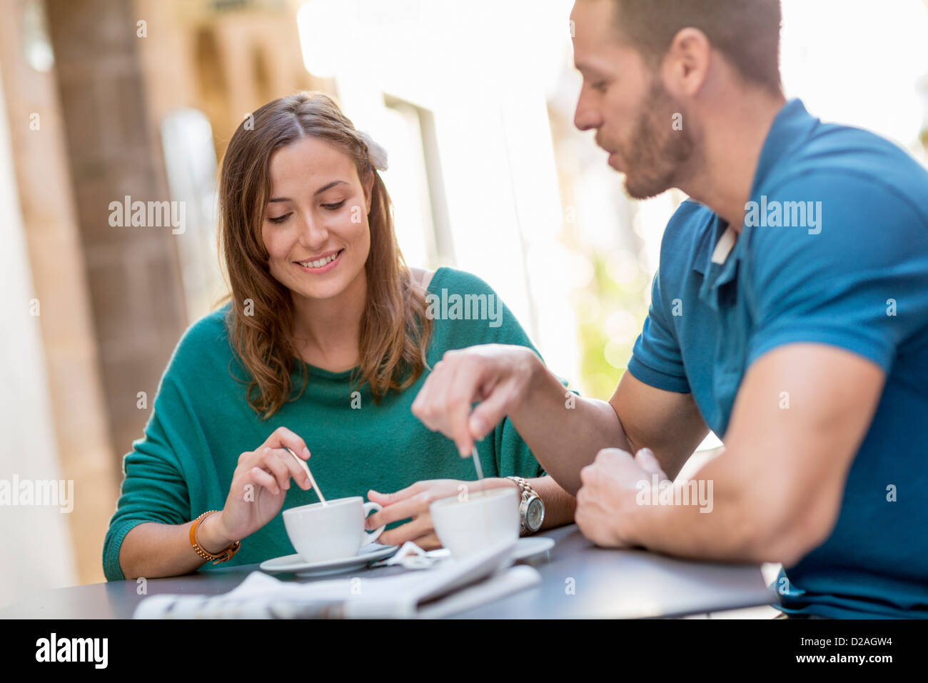 Couple having coffee at sidewalk cafe - Stock Image