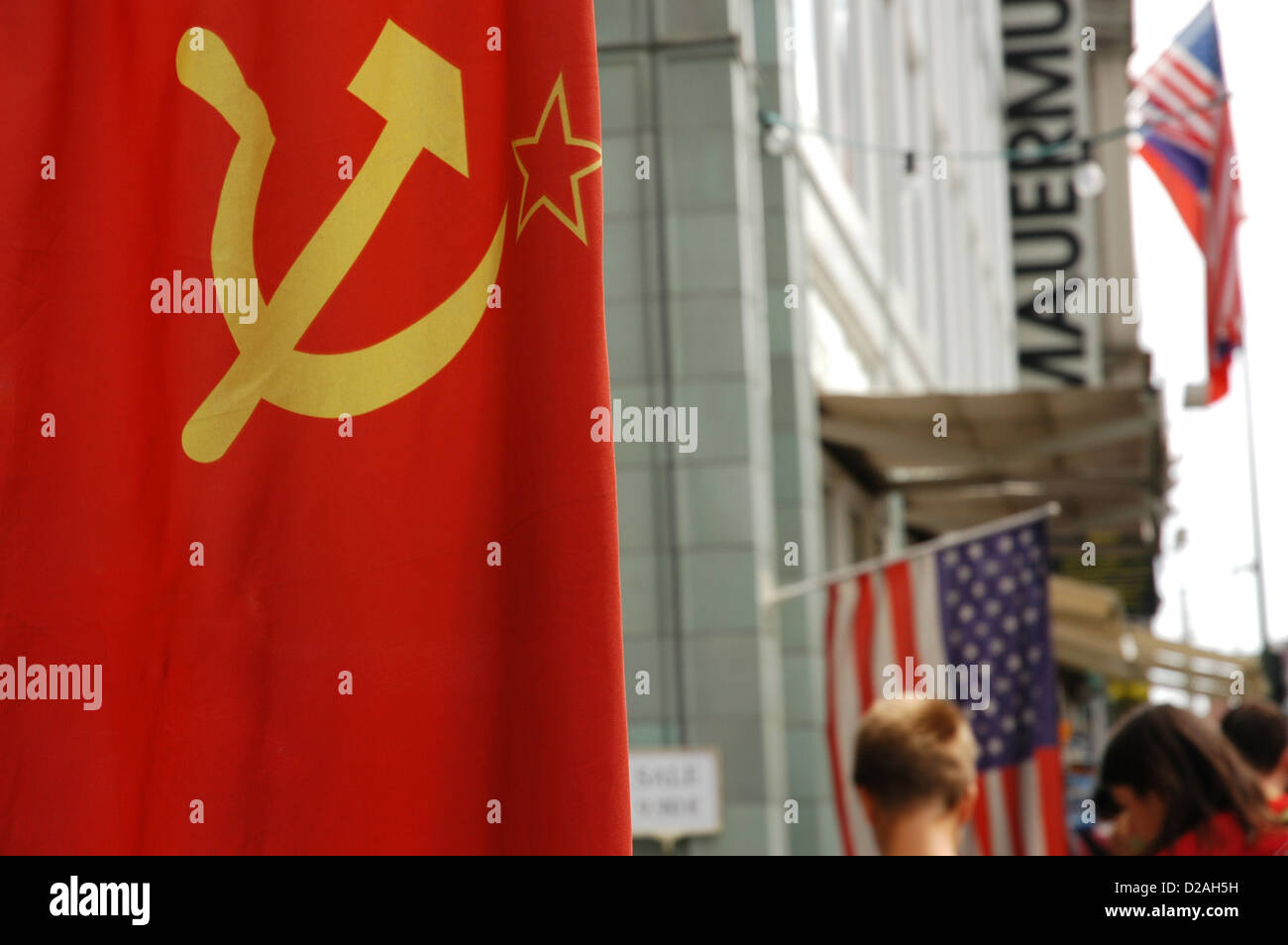 Flag of the former USSR in Checkpoint Charlie. Berlin. Germany. - Stock Image