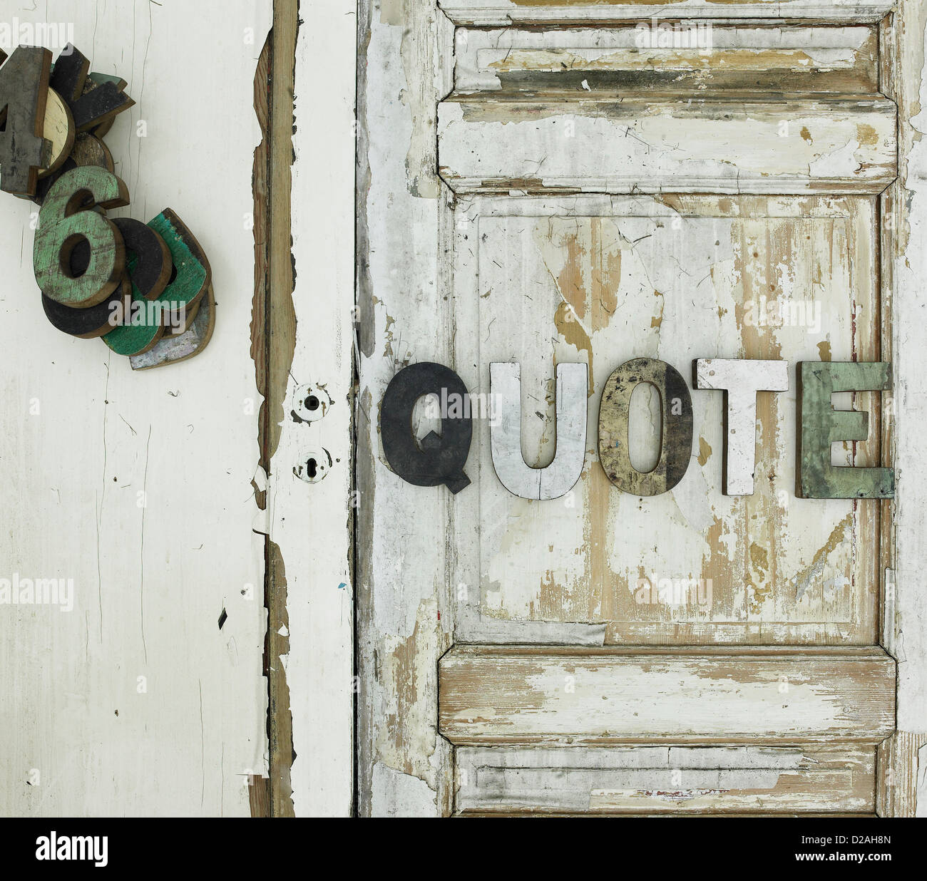 Quote nailed on wooden door - Stock Image