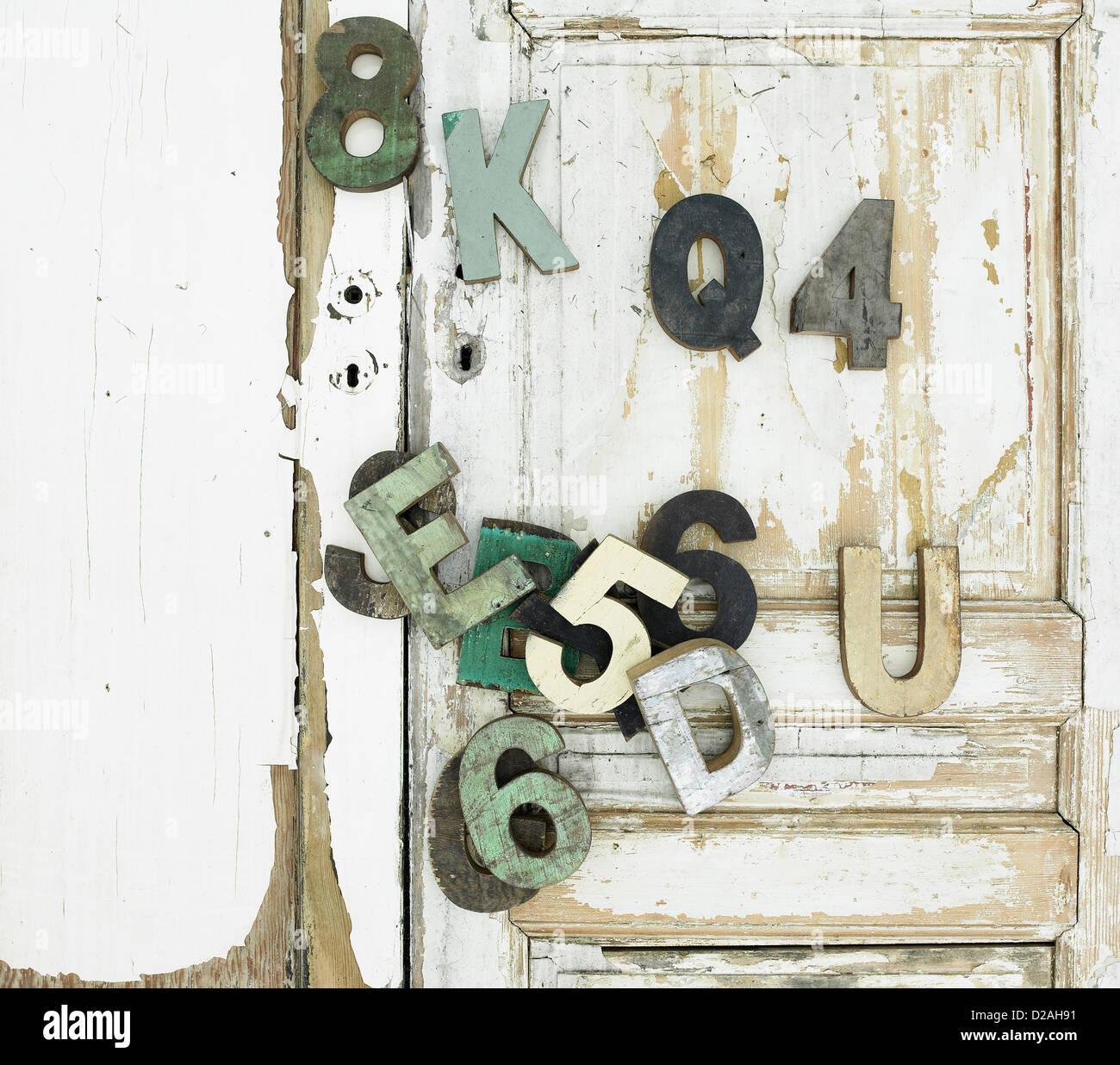 Decorative wooden symbols on door - Stock Image