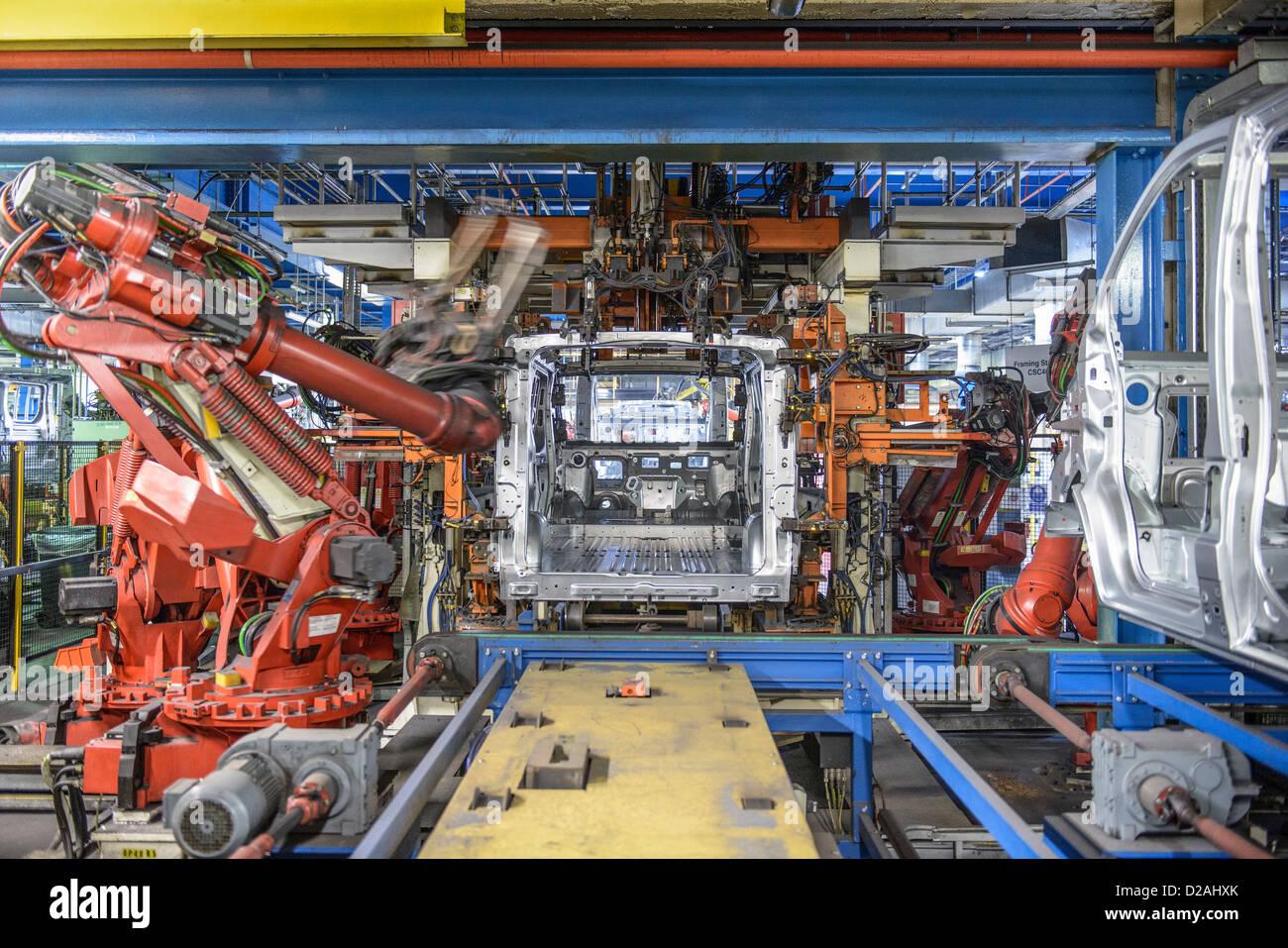 Robots welding van body in car factory Stock Photo