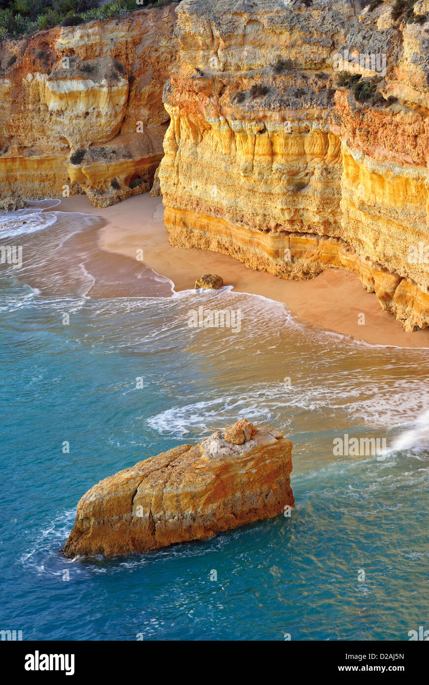 Portugal, Algarve: Bird ´s-eye view to unreachable beach at the coast of Carvoeiro - Stock Image