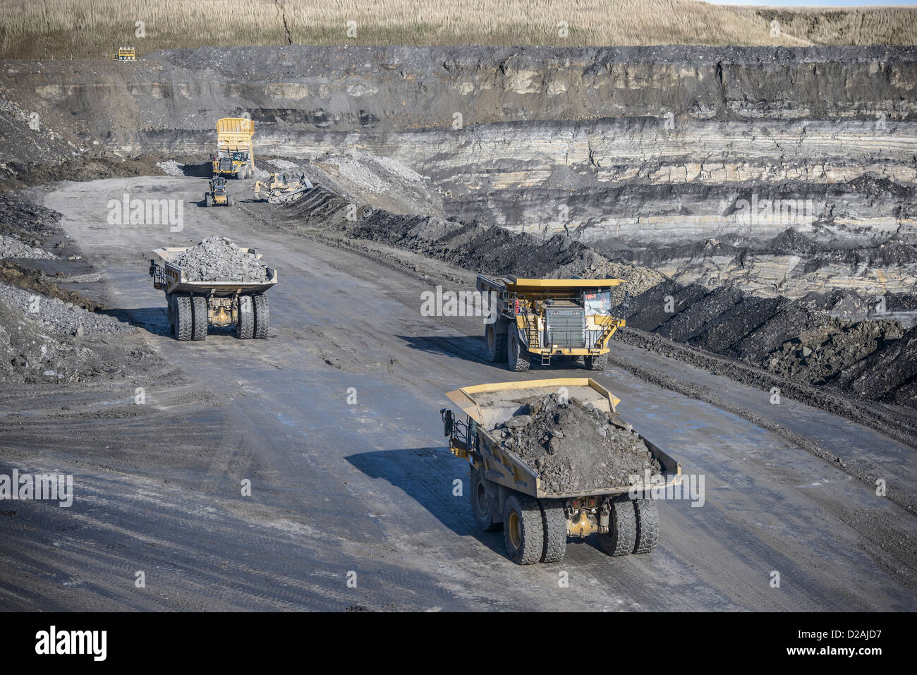 Trucks with coal rocks at surface mine Stock Photo